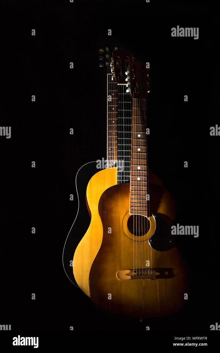 Three Acoustic Guitars On Black Background Isolated Stock Photo