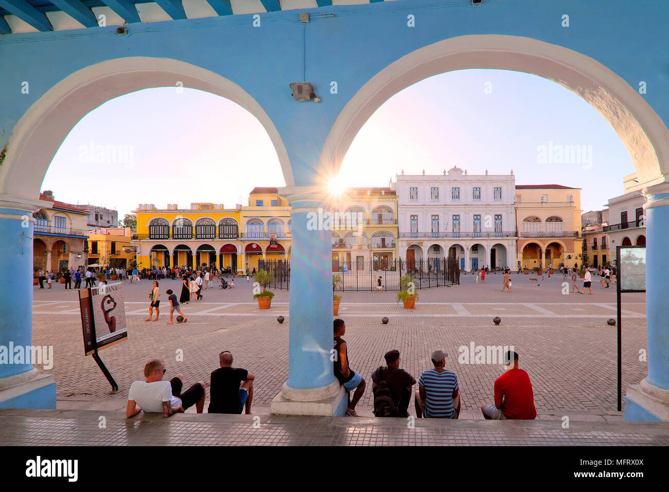 Sun setting over the colorful colonial buildings on Plaza Vieja / Old Square, Havana, Cuba - Stock Image
