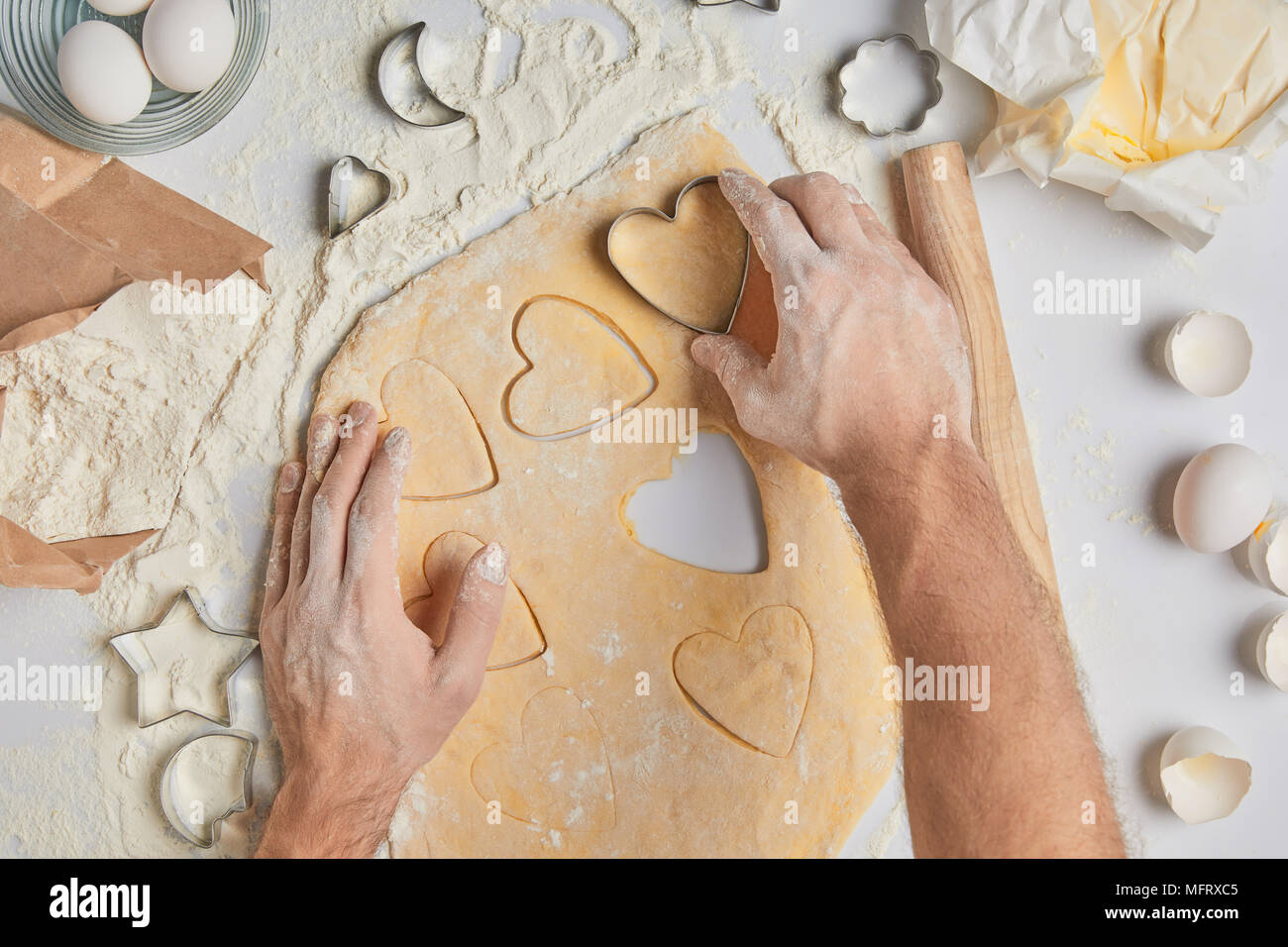 cropped image of chef preparing heart shaped cookies, valentines day concept - Stock Image