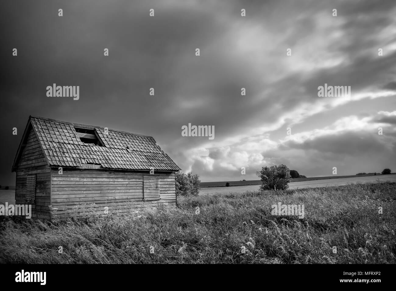 Derelict building on Salisbury plain on a stormy day, Wiltshire - Stock Image