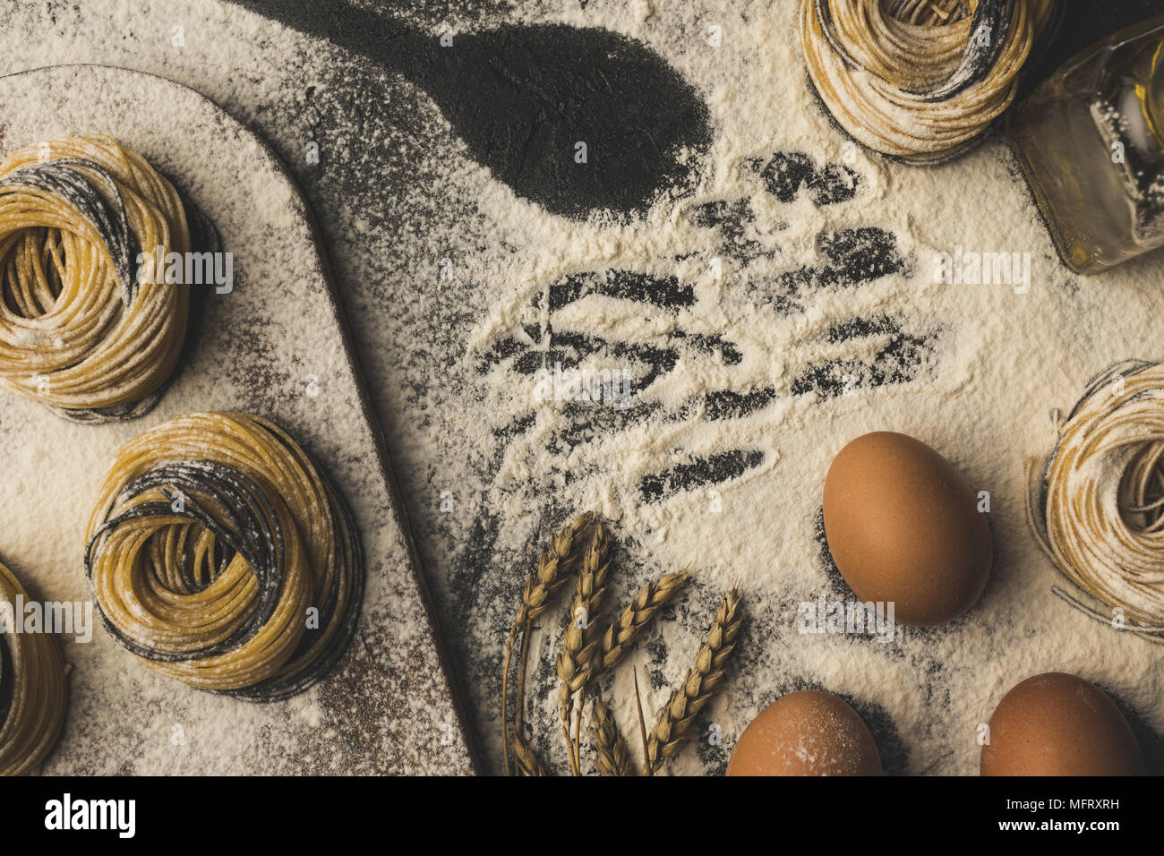 raw pasta and ingredients composition - Stock Image