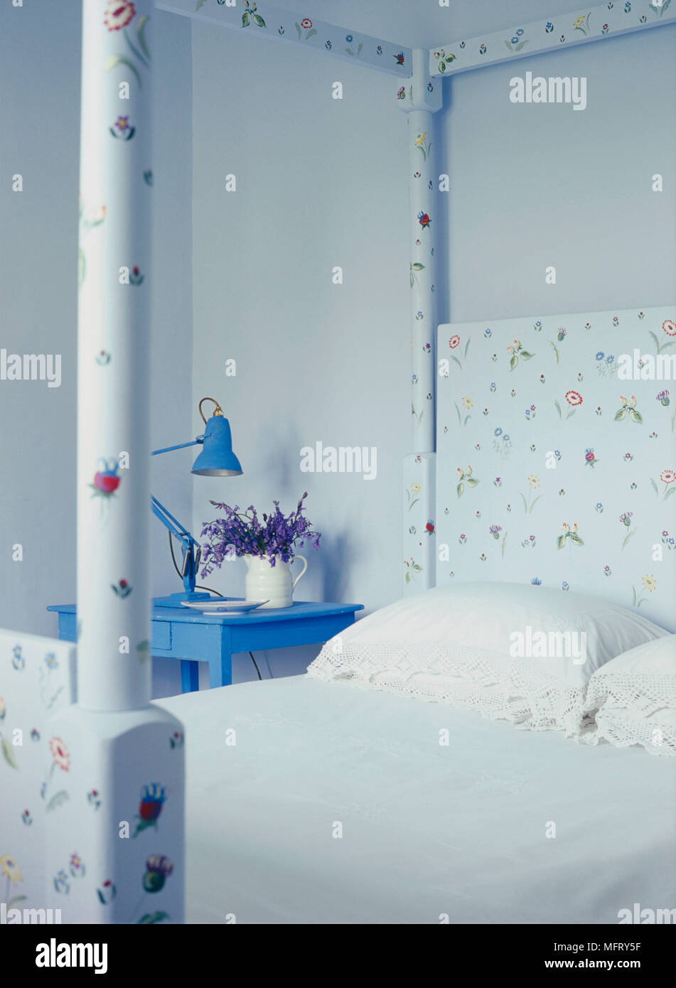 A Detail Of A Modern Country Blue Bedroom With A Decoratively Painted Four Poster Bed And Side Table Stock Photo Alamy