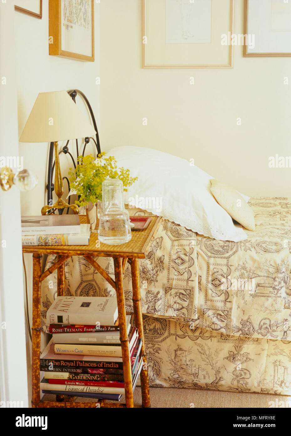 A Detail Of A Traditional Neutral Bedroom With Wrought Iron Double Bed Bamboo And Rattan Bedside Table Stock Photo Alamy