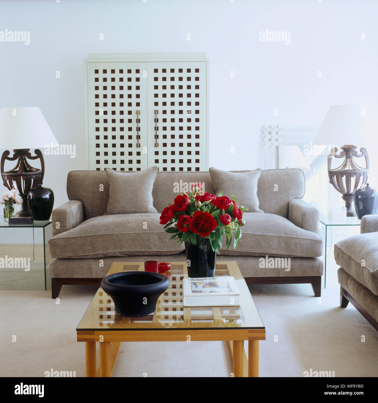 A Modern Neutral Sitting Room Upholstered Sofa Wood Coffee Table