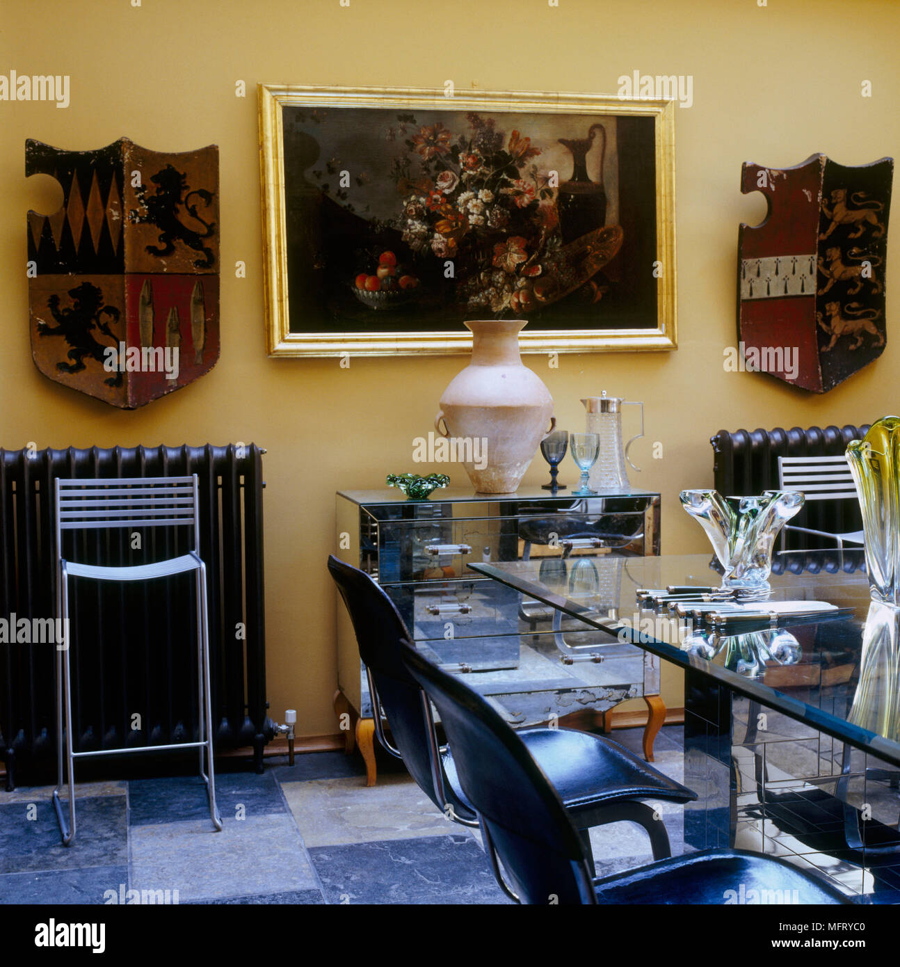 A modern yellow dining room glass table chairs mirrored ...