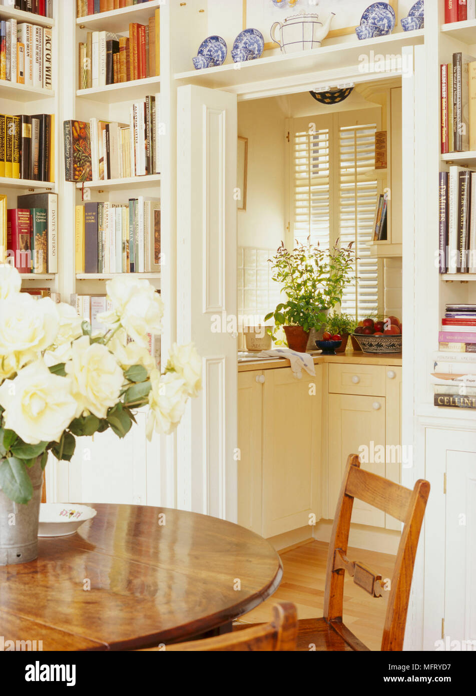 A Traditional Neutral Dining Room With Round Wood Table And