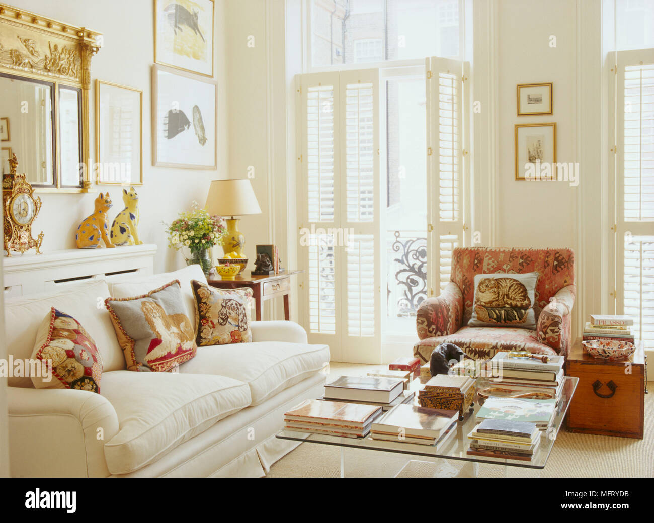 A traditional neutral sitting room with upholstered sofa and ...