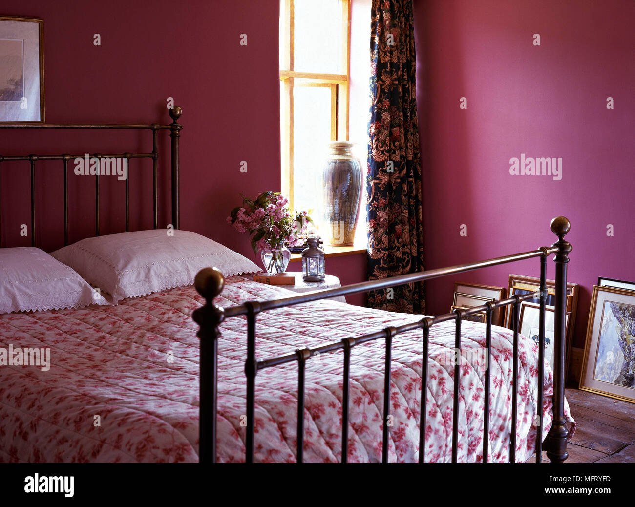 Bright purple painted bedroom iron bed frames pink and floral ...