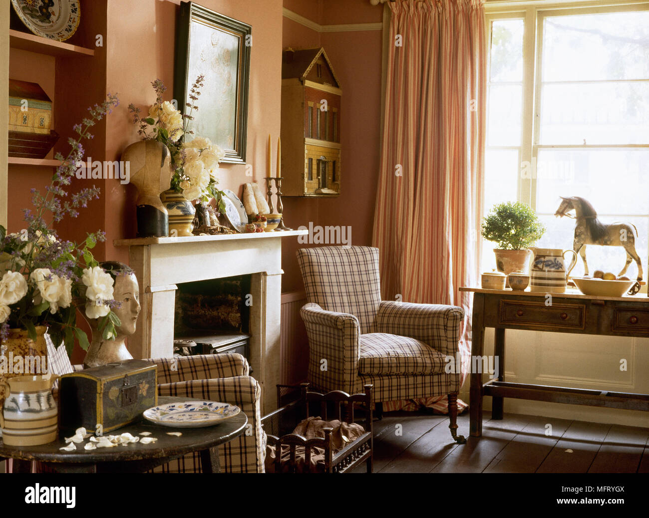 Country red sitting room fireplace upholstered pattern ...