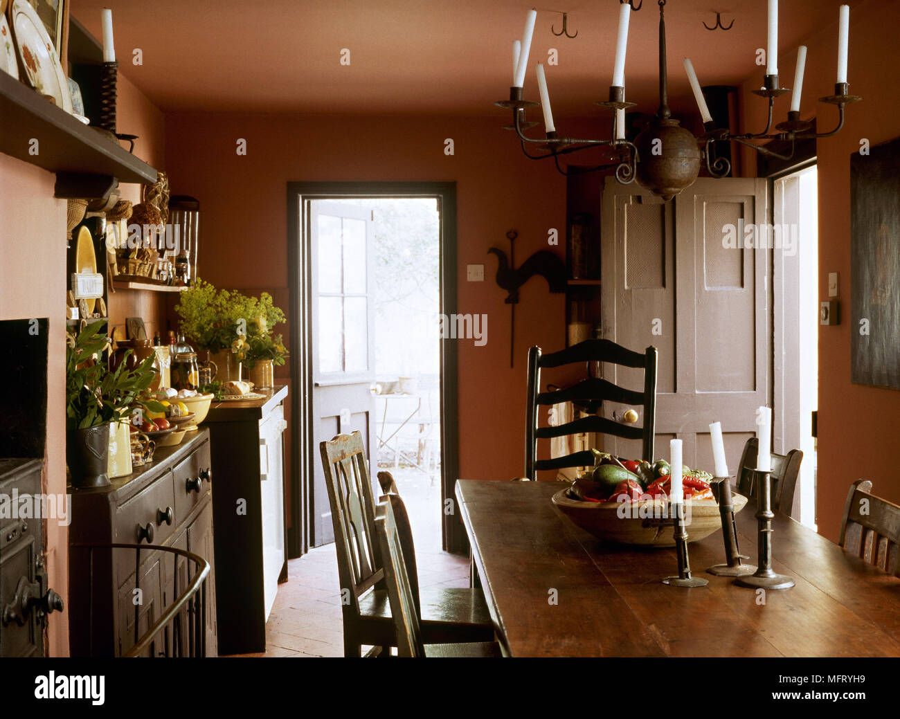 Picture of: Country Terracotta Dining Room Wooden Table Chairs Wrought Iron Chandelier Interiors Rooms Traditional Period Features Furniture Rustic Oak Stock Photo Alamy
