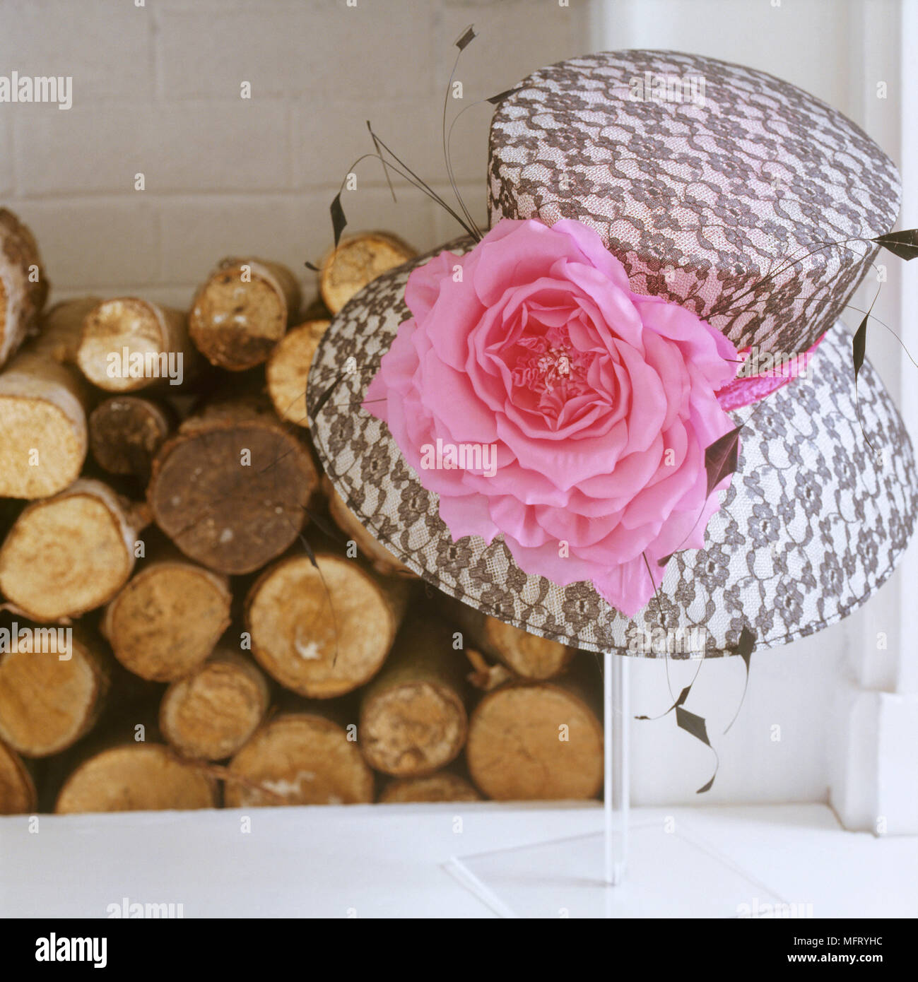 Detail Of A Fireplace Hearth Piled With Logs A Black And White Hat