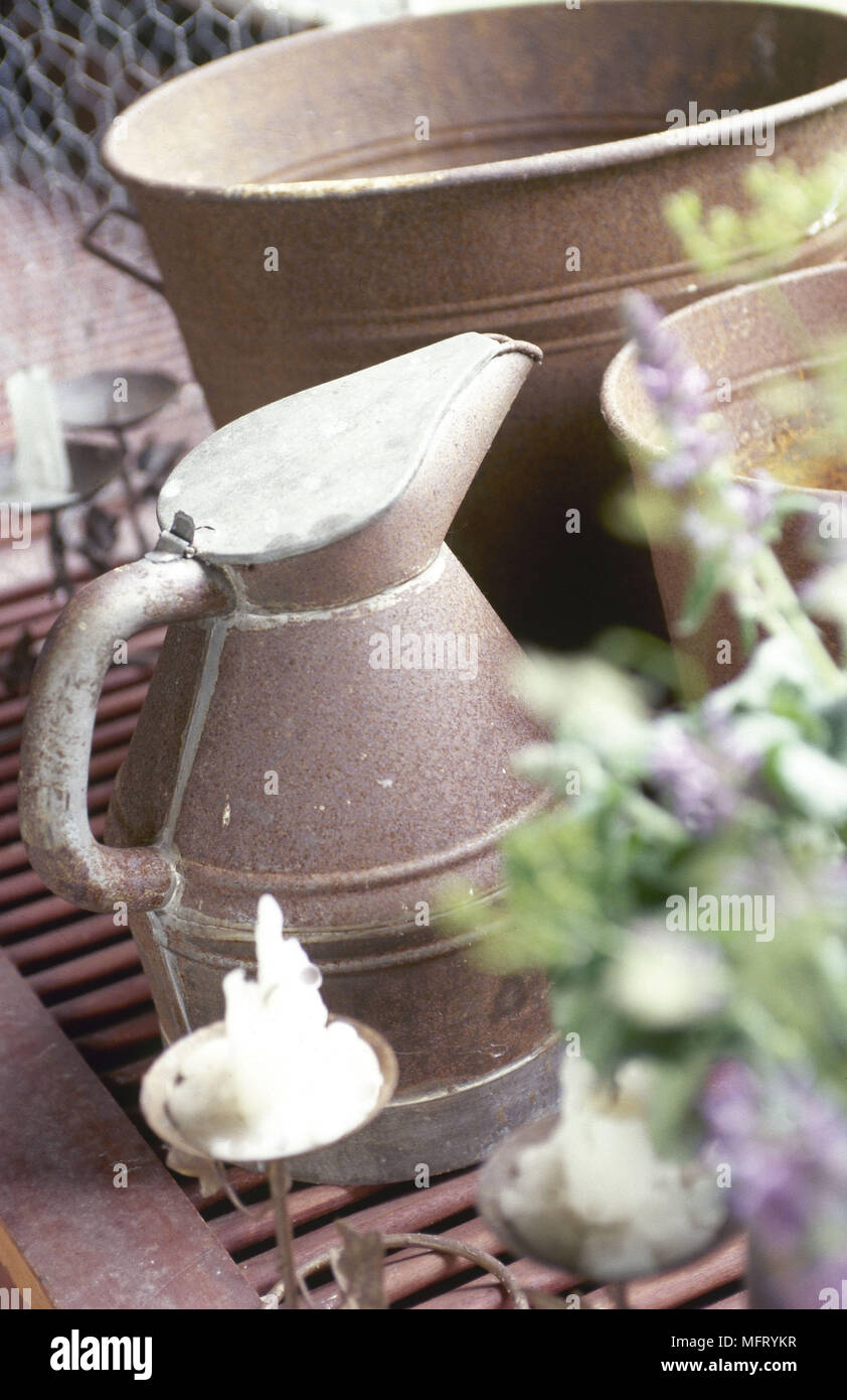 Metal waterjug and buckets  detail - Stock Image