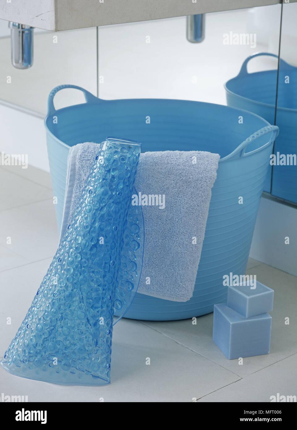 Blue plastic bucket with bath matt and soaps Stock Photo: 181850374 ...