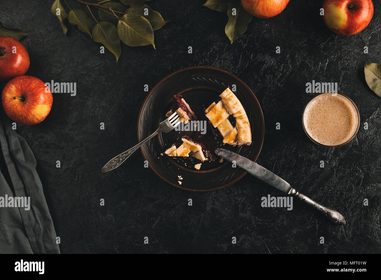 cut piece of apple pie on plate - Stock Image