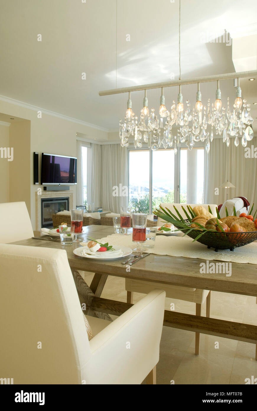 Pendant Light Above Table Set For Lunch In Modern Dining Room Stock Photo Alamy