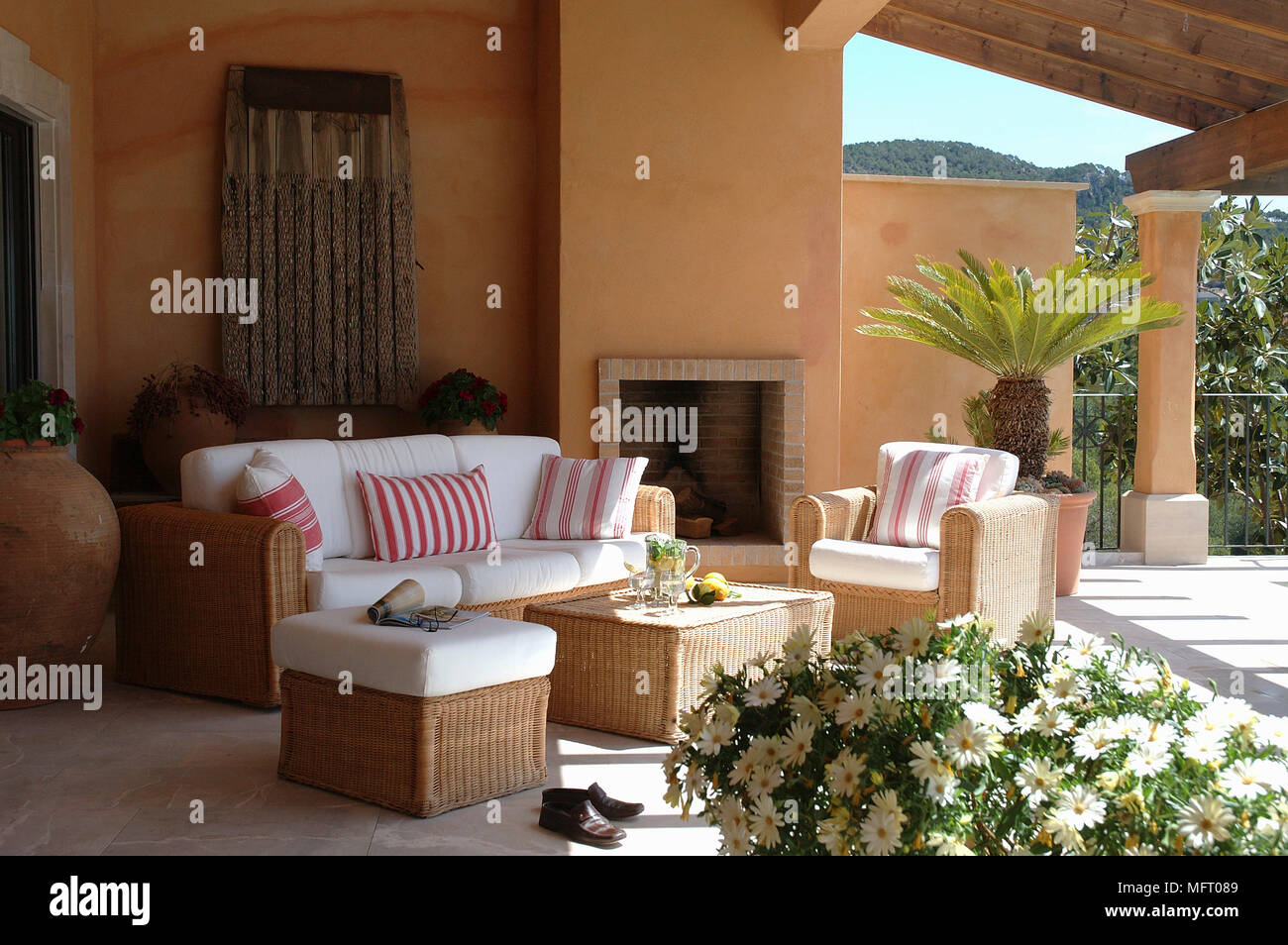 Wicker Furniture On Covered Patio Terrace With Fireplace Stock Photo Alamy