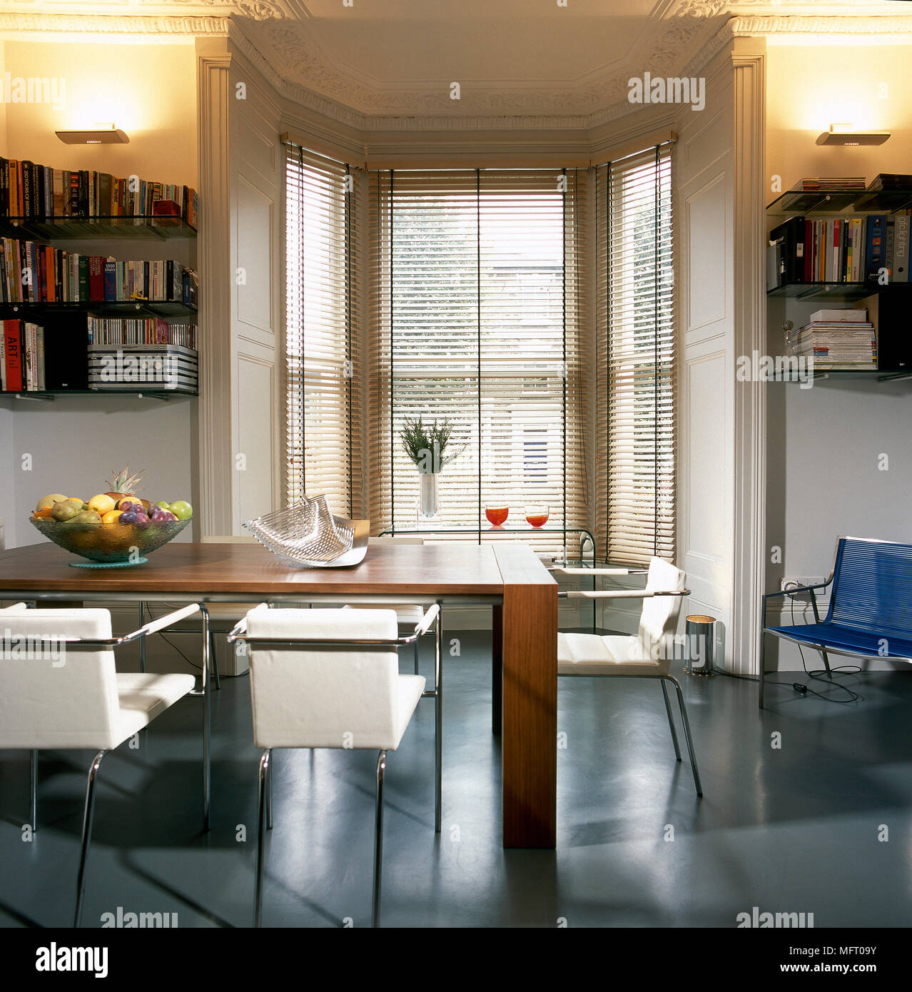 Modern Dining Room With Bay Window With Venetian Blinds Table And Chairs Stock Photo Alamy