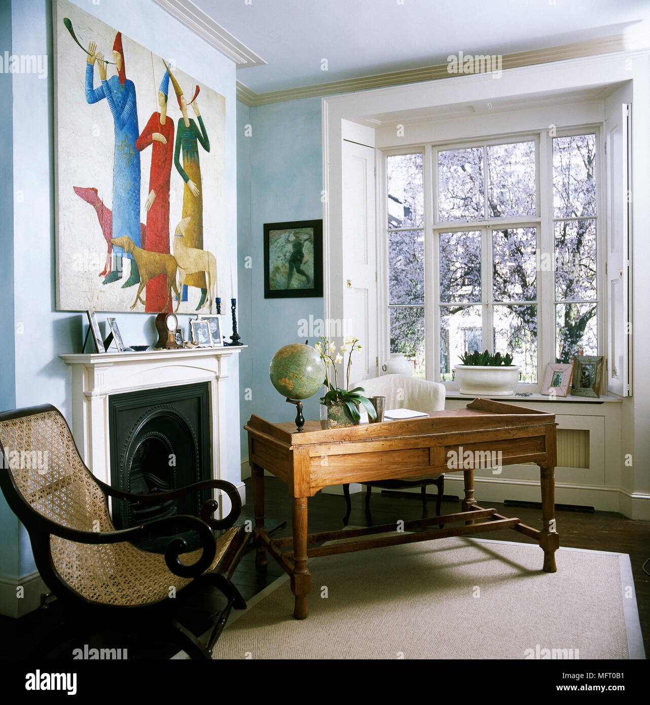 Traditional Sitting Room With A Wicker Chair And Wooden