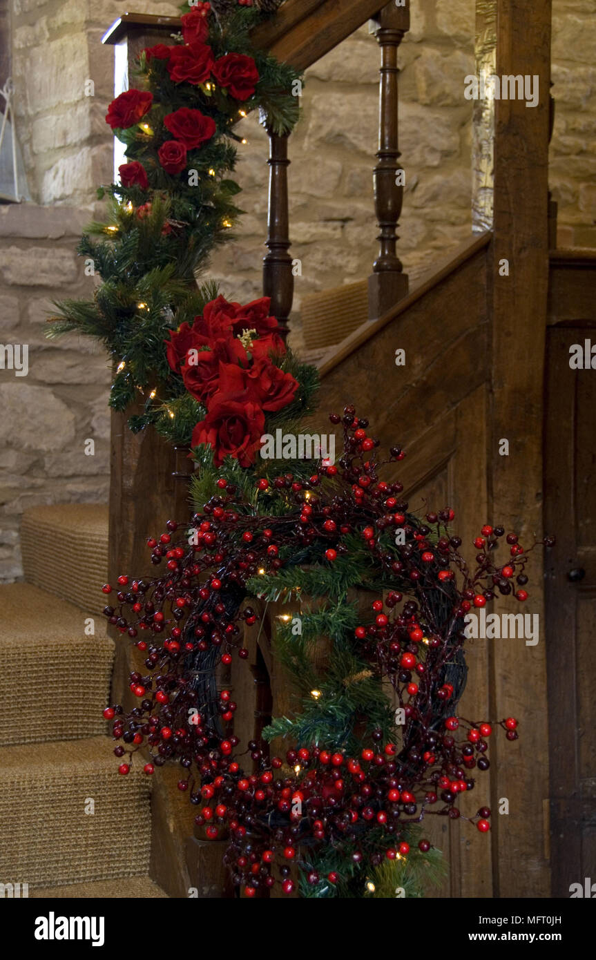 Christmas Garland Of Red Flowers And Foliage With Wreath Of Berries