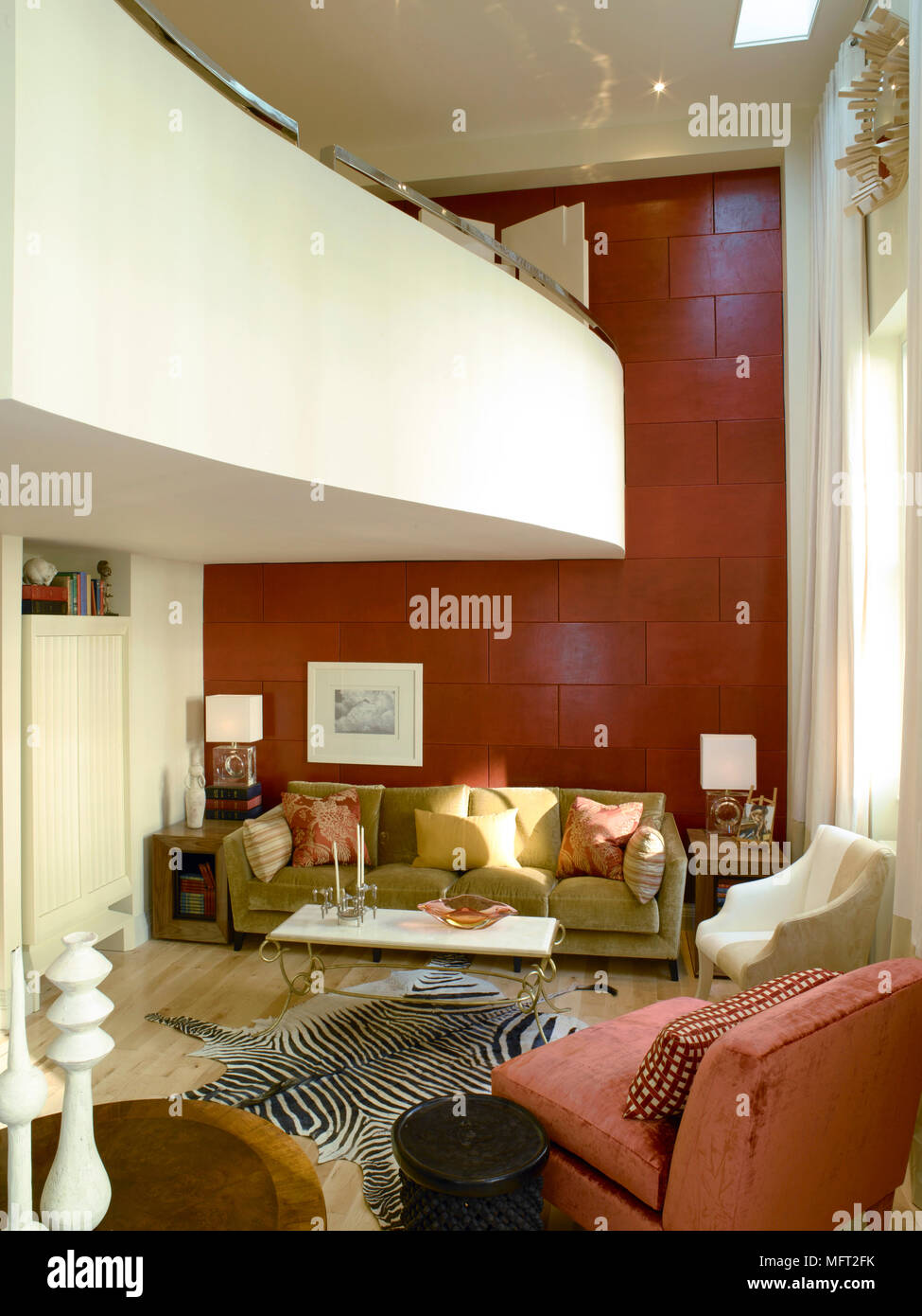 Modern sitting room with red accent wall, curving balcony ...