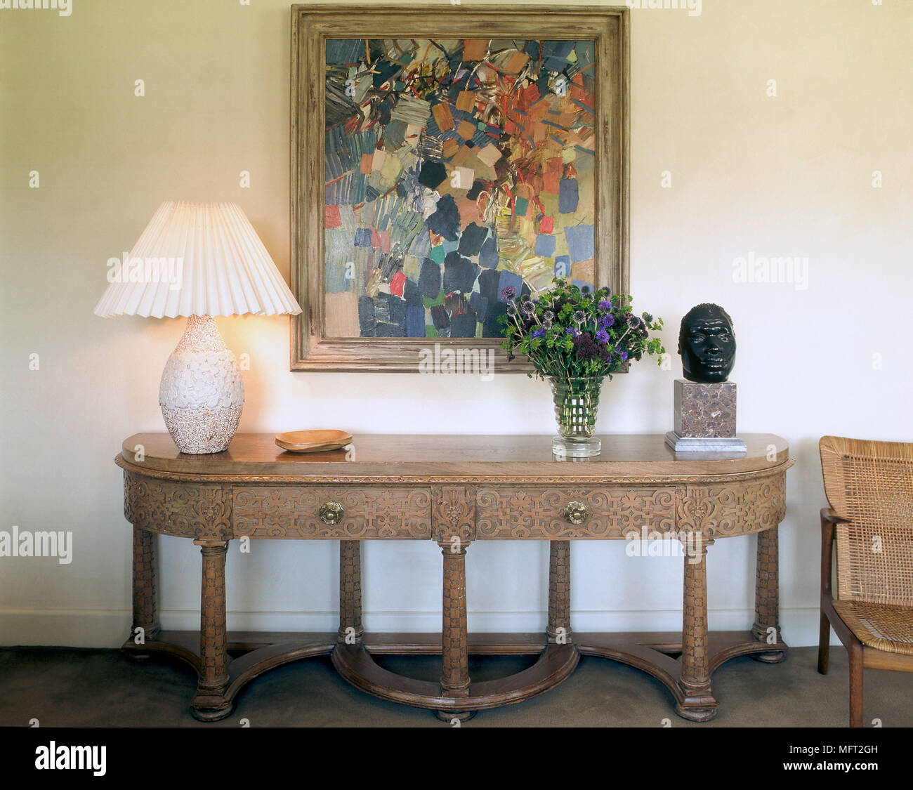 A Detail Of Traditional Dining Room With Decorative Carved Sideboard Lamp Abstract Artwork