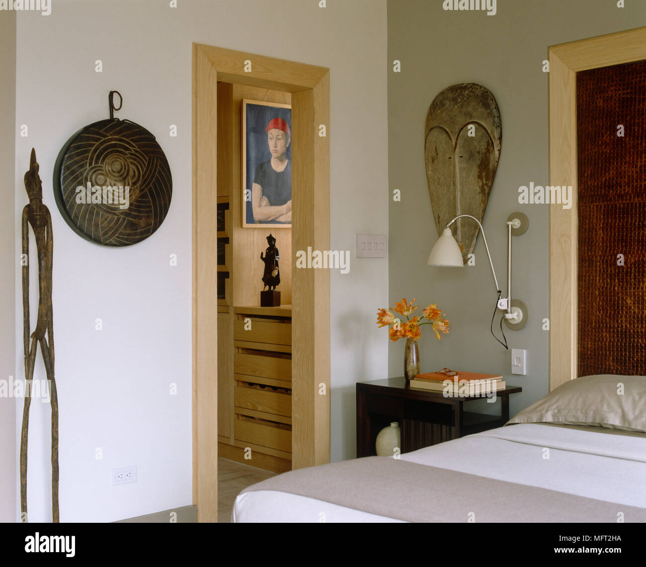 Wall Lamp Above Bedside Cabinet Next To Double Bed With View To Open