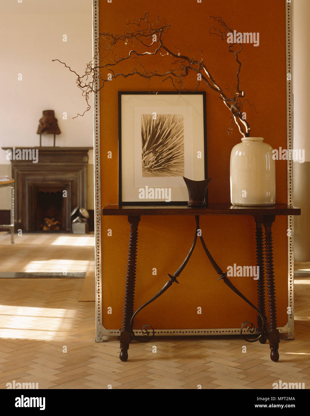 dark wooden side table next to terracotta wall - Dark Wooden Side Tables