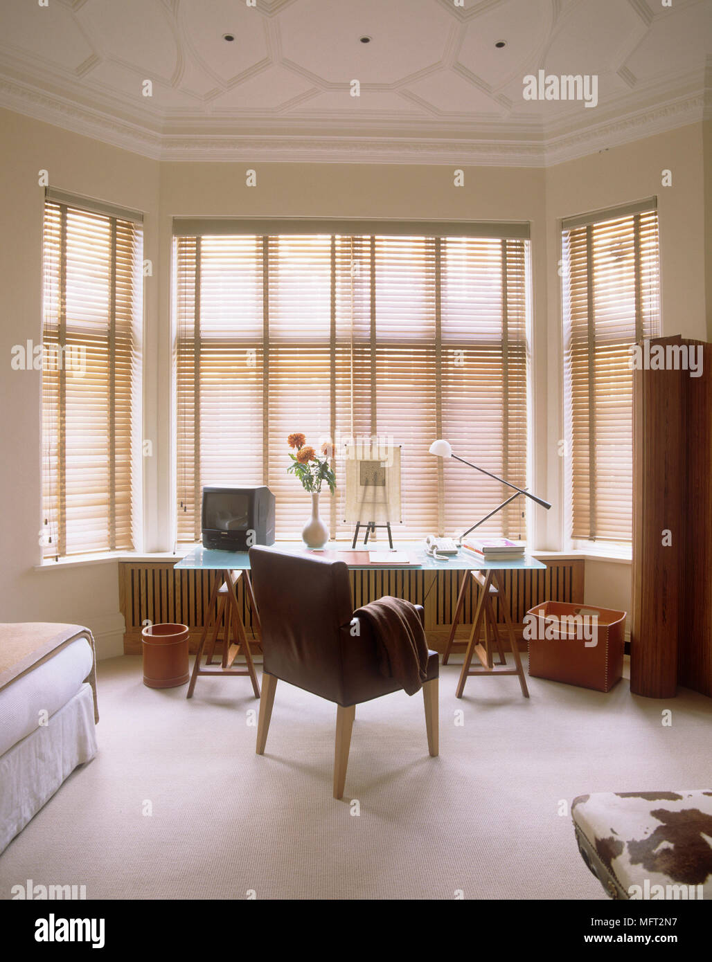 Glass Top Table In Bedroom With Upholstered Chair Set In Bay Window Stock Photo Alamy