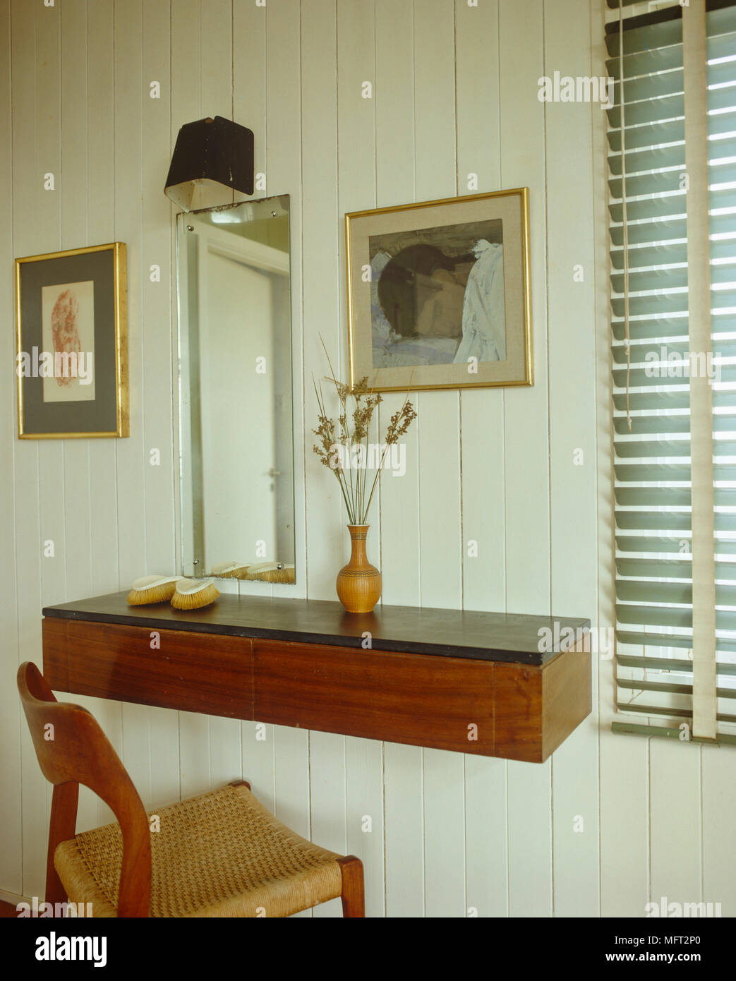 Mirror Above Wooden Wall Mounted Dressing Table With Wooden Chair