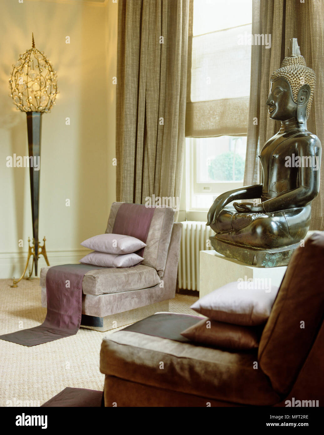 Eastern inspired dining room with low purple chairs and ...