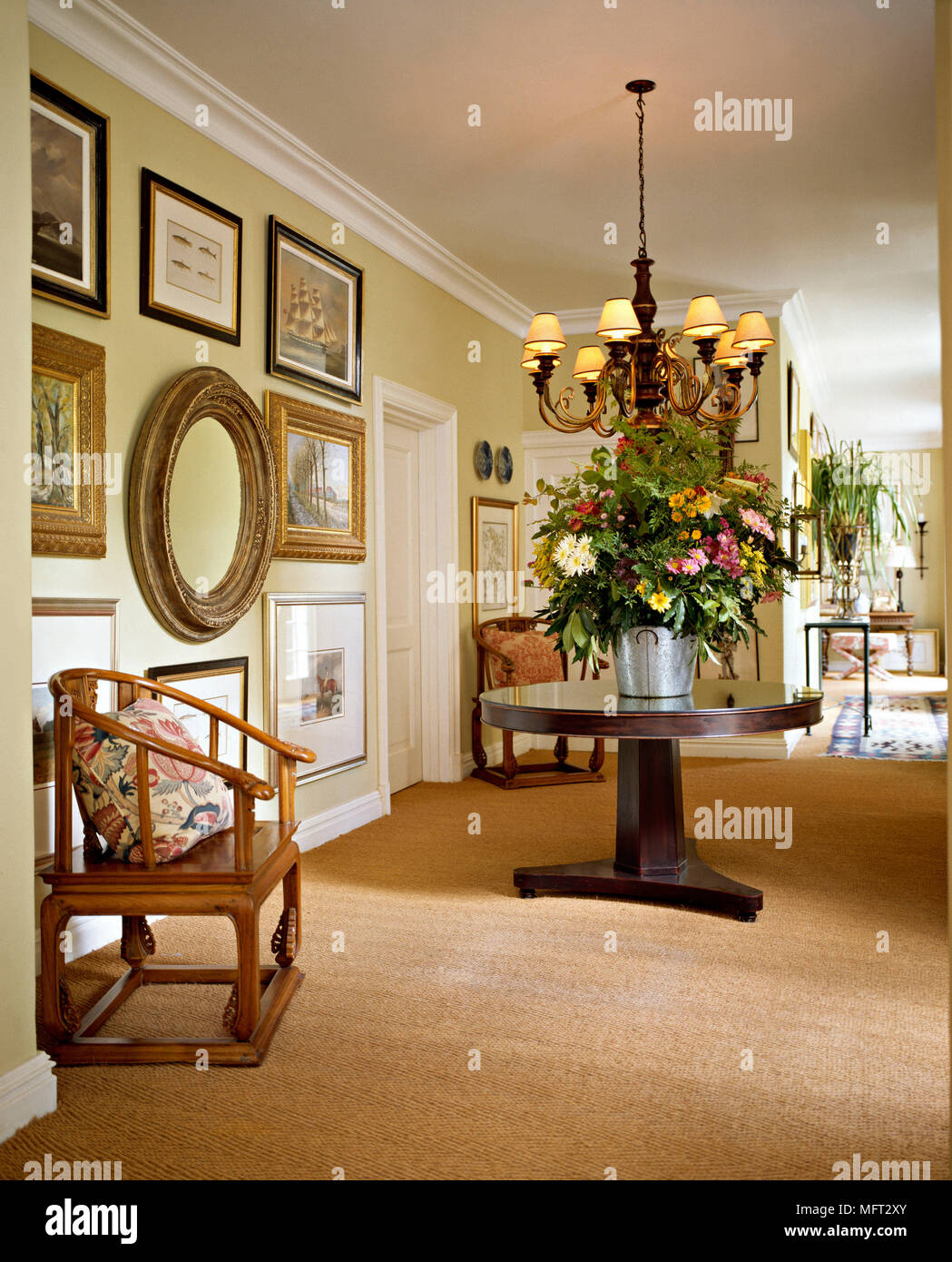 Traditional Yellow Hallway Carpet Pedestal Table Flower Arrangement Wood  Chair Chandelier Interiors Halls Hallways Period Furniture Features Spacious