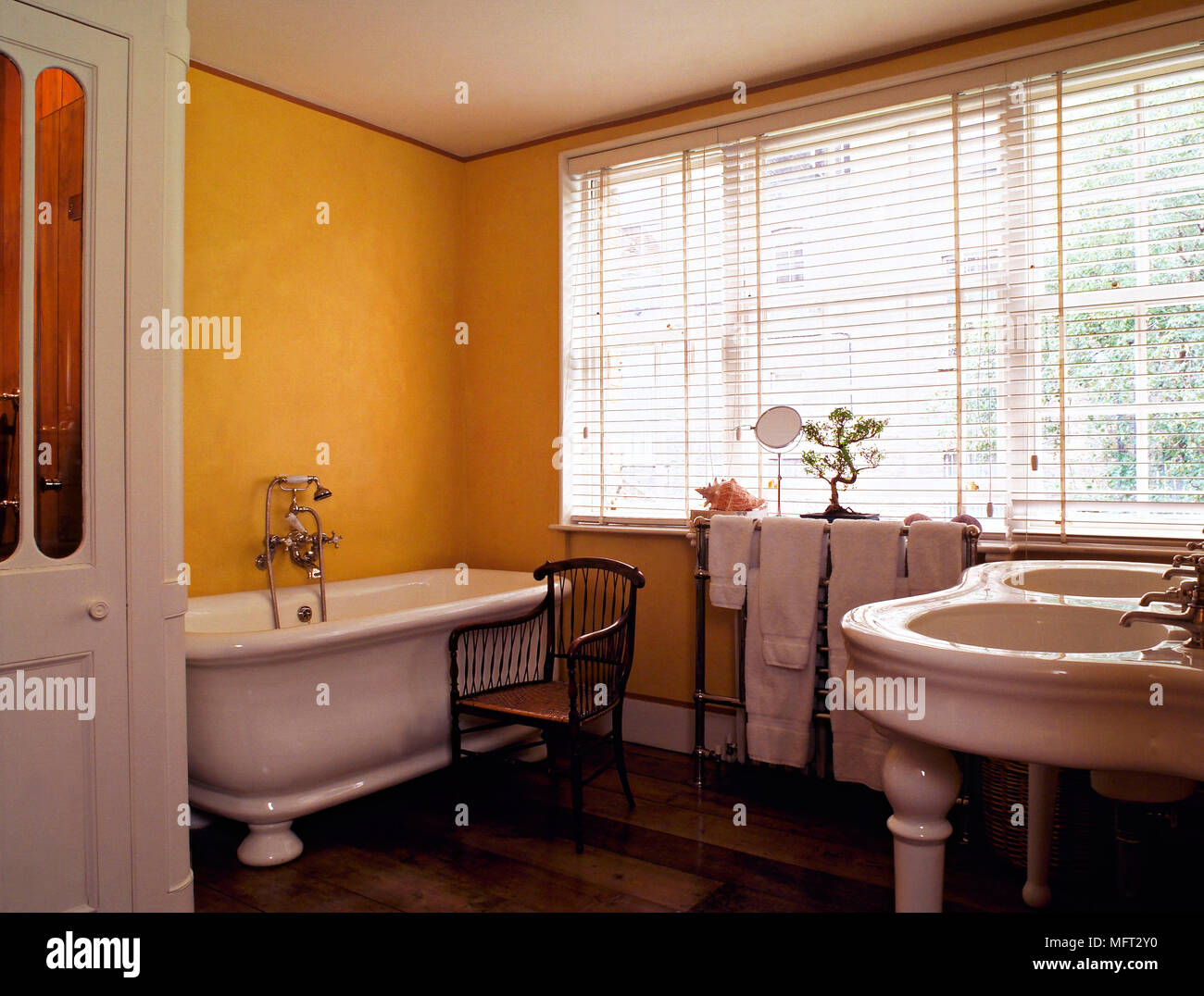 Traditional Yellow Bathroom Freestanding Roll Top Bath Twin Washbasin  Interiors Bathrooms Venetian Blinds Baths Sinks Period