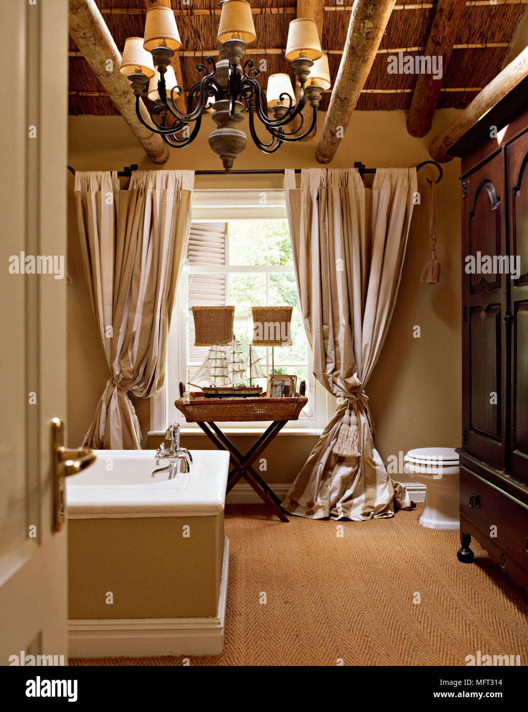 Traditional bathroom detail timber beamed ceiling bath wrought iron ...