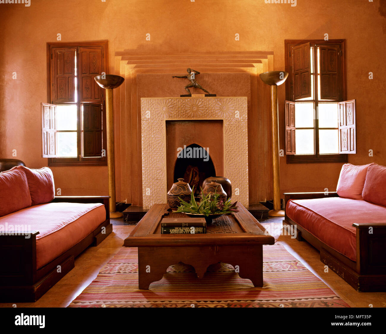 Moroccan hotel suite sitting room fireplace coffee table ...