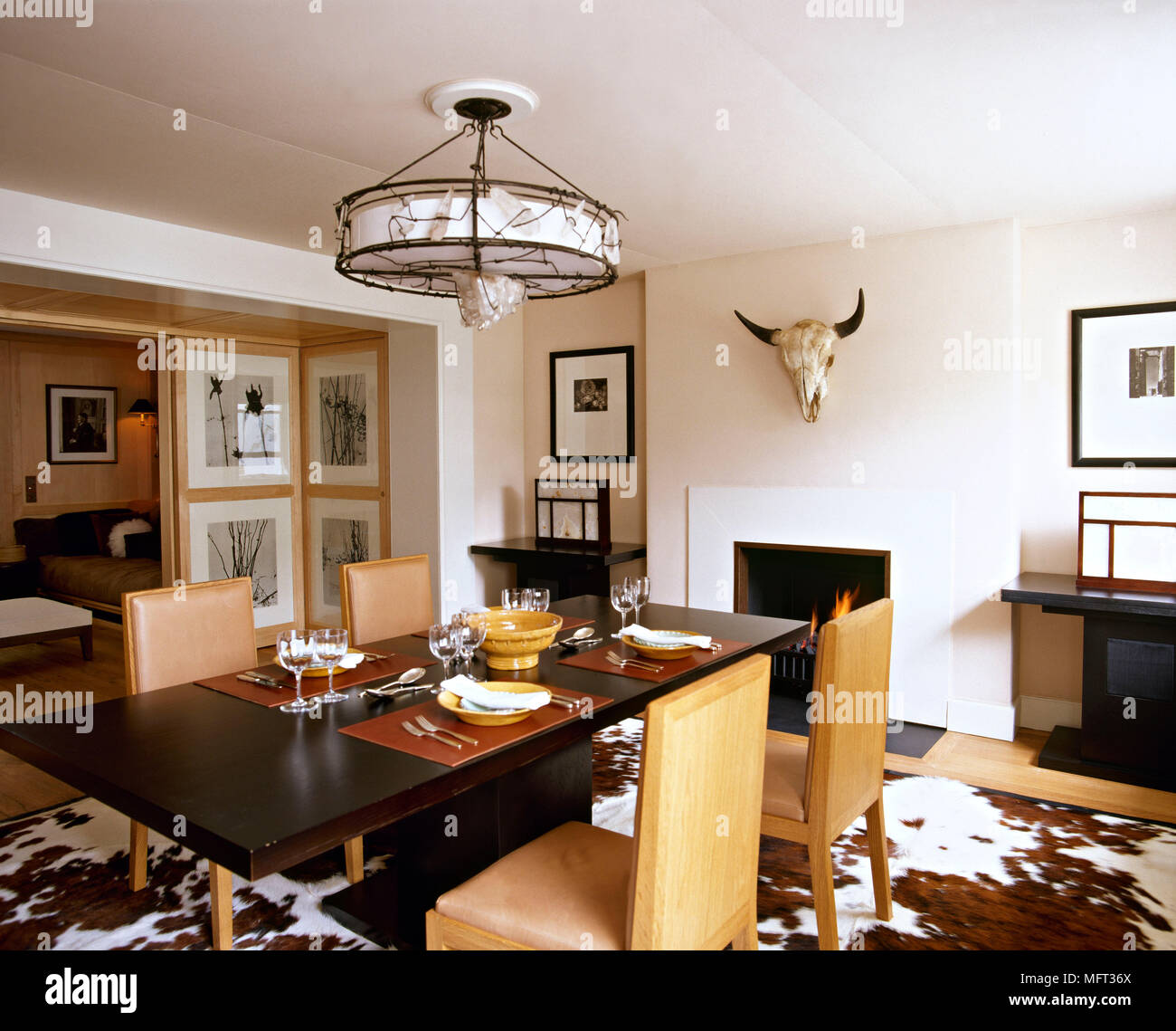 Modern;dining Room Wood Table Leather Chairs Cowskin Rug Table Setting  Interiors Rooms Brown Earth Colours Animal Skin