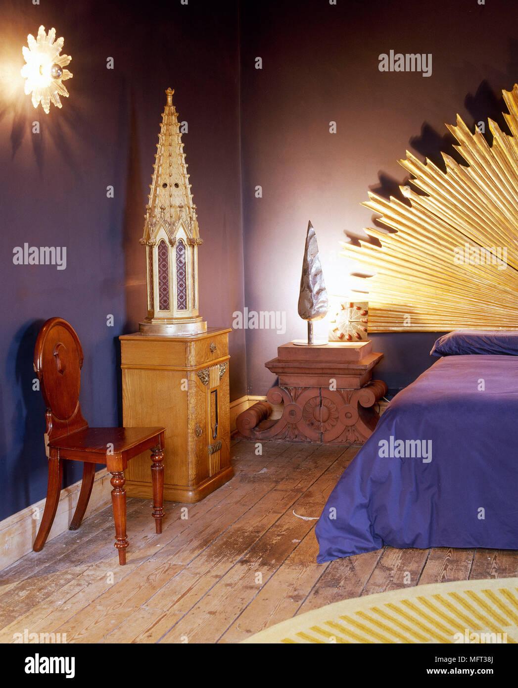 Modern purple bedroom stripped floorboards blue bed cover ...