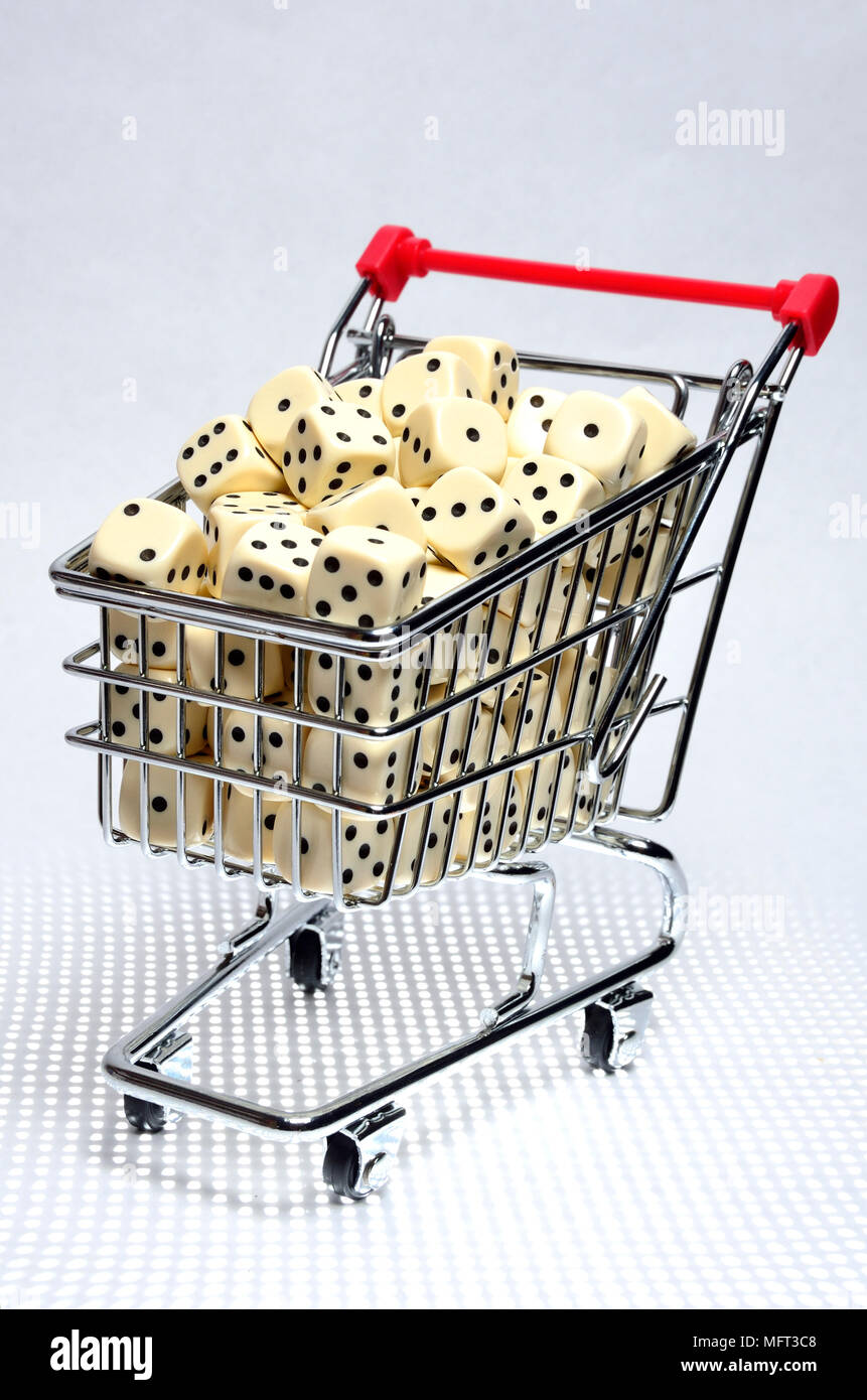 Dice in a shopping trolley - Stock Image