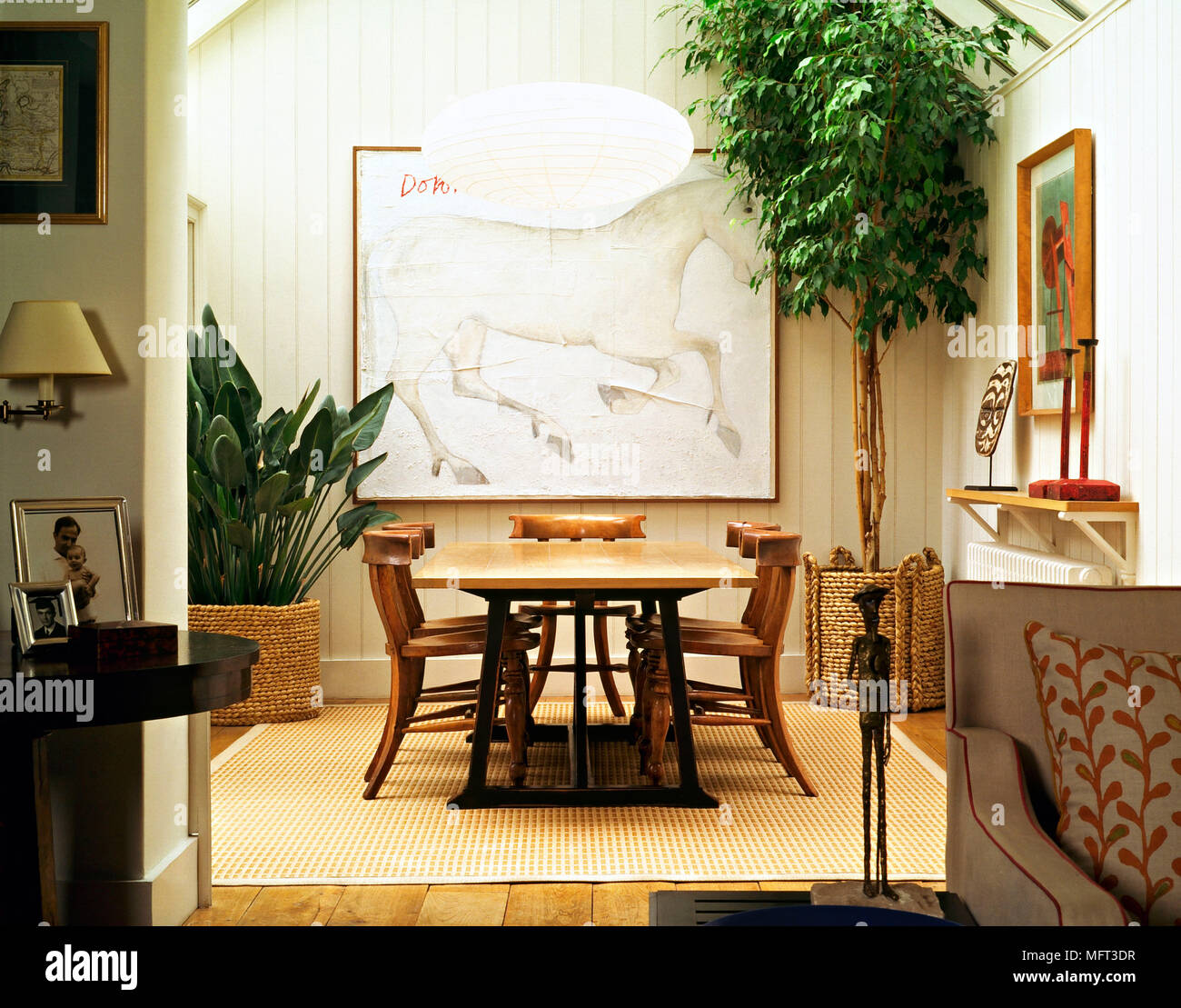 Modern Country Dining Room Wood Panelling Table Chairs Wicker Planters  Indoor Plants Interiors Rooms Double Room Through Room Through Room Natural  Co