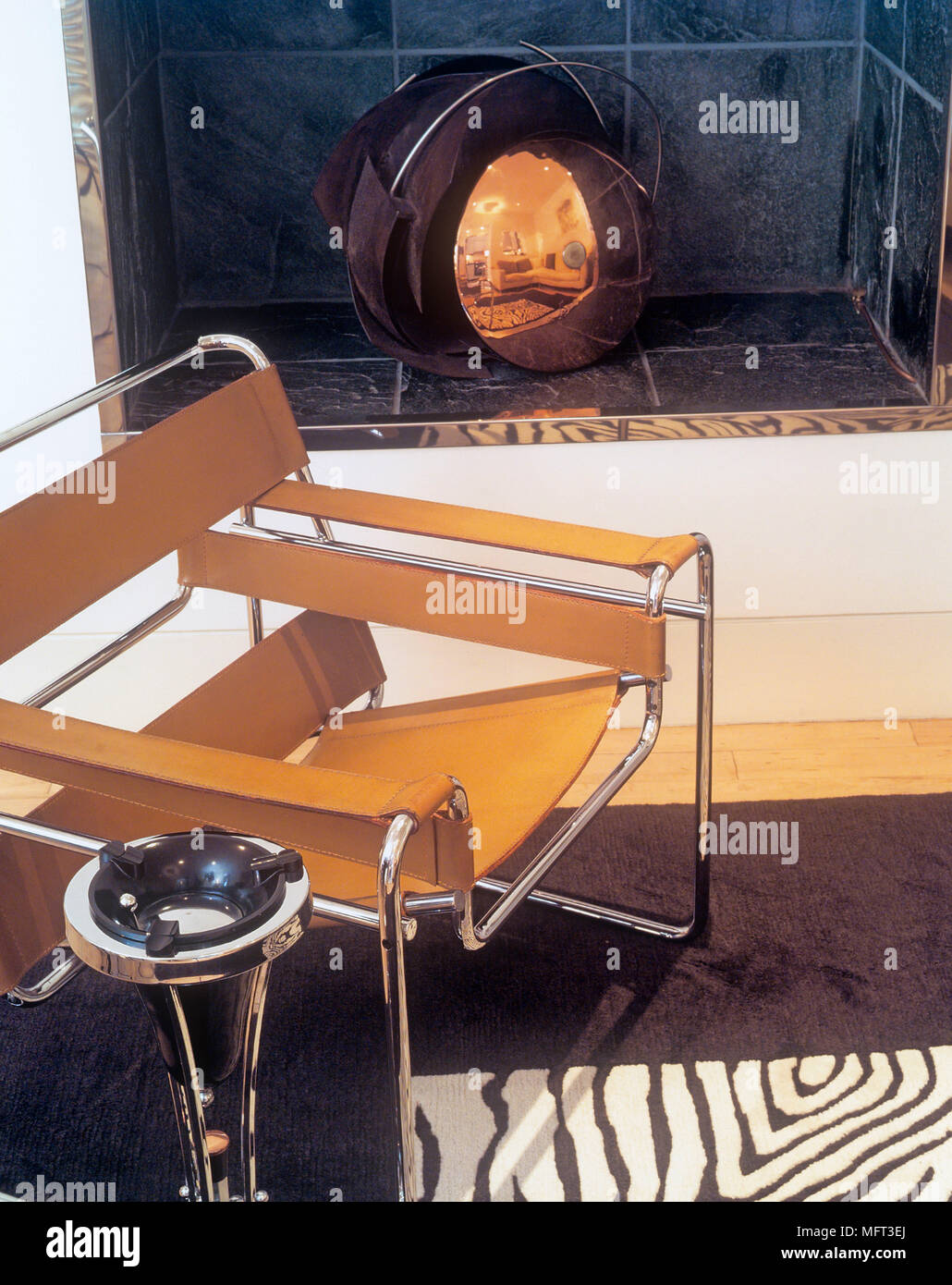Marcel Breuer Wassily chrome and tan leather chair - Stock Image