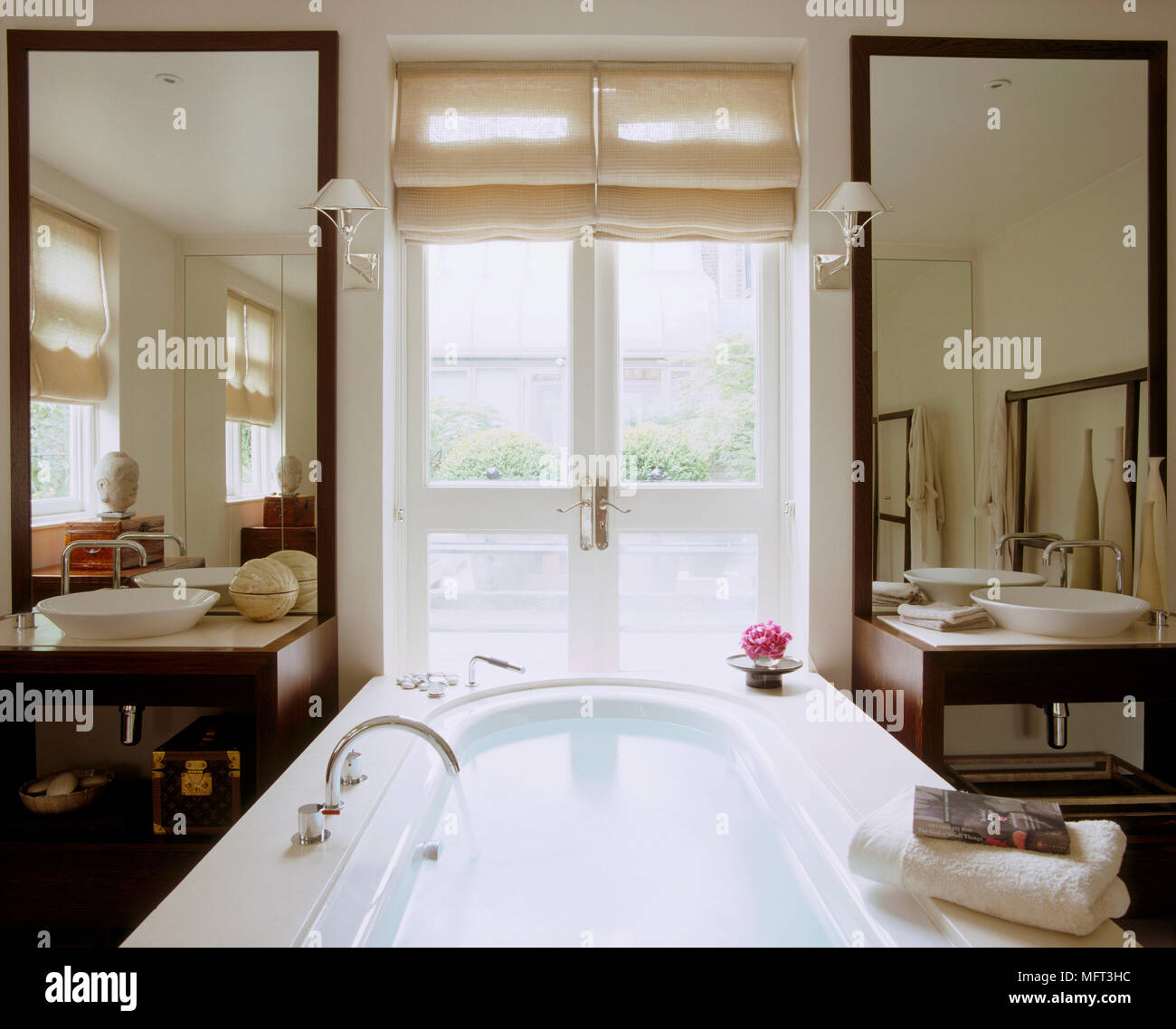 Freestanding bath in centre of bathroom with matching washbasins and ...