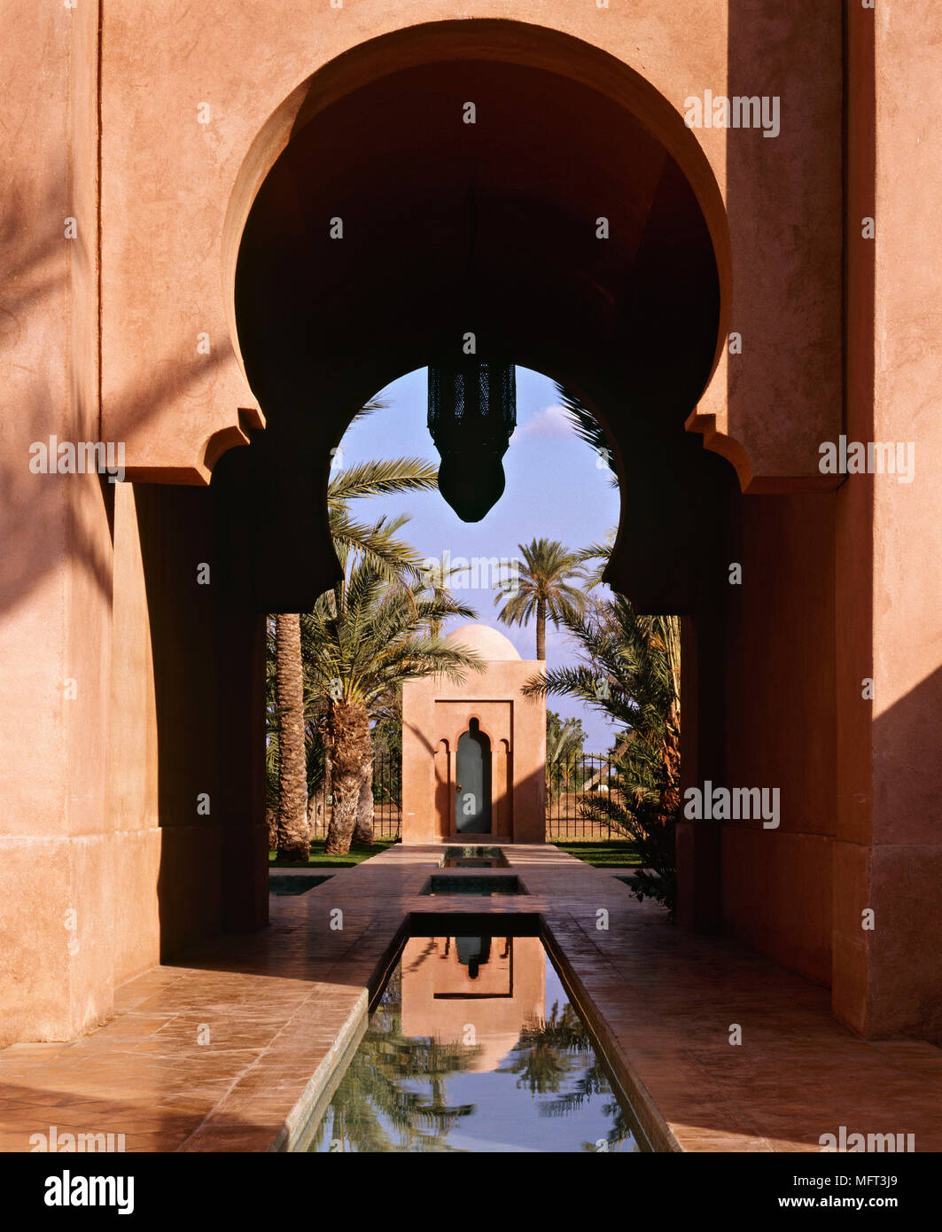 Exterior Moroccan house palm trees water pool Exteriors architecture