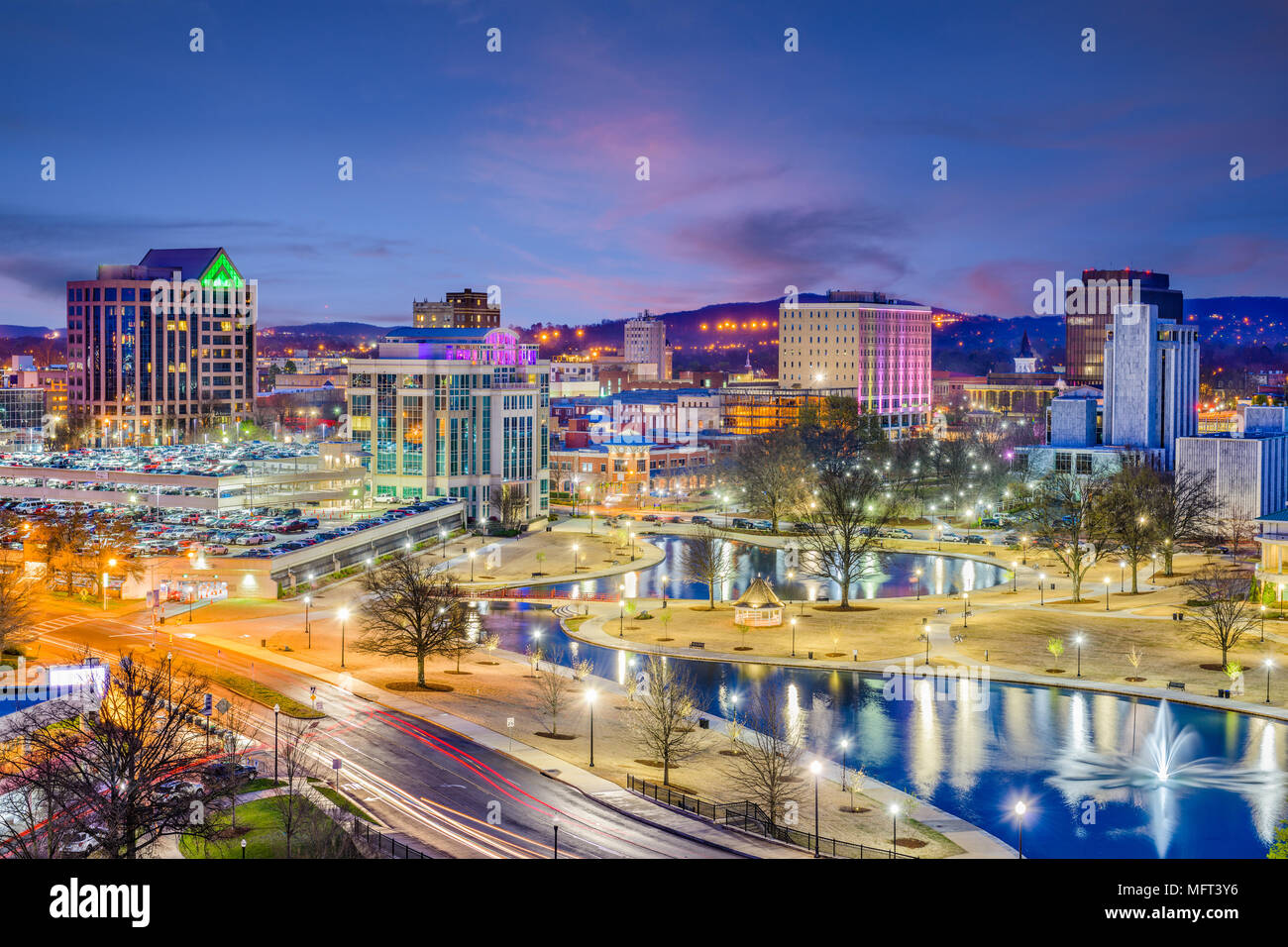 Huntsville, Alabama, USA park and downtown cityscape at twilight. - Stock Image