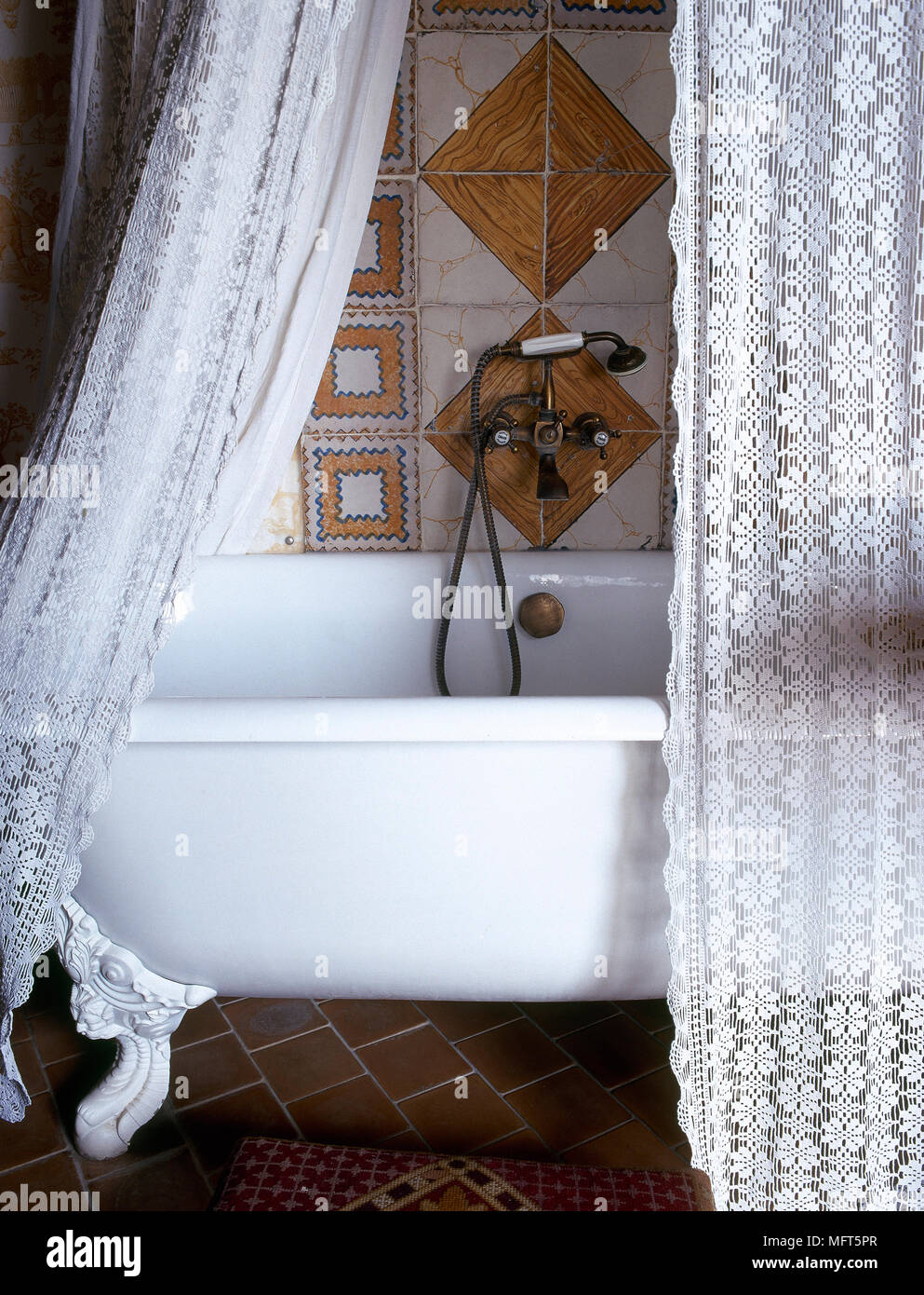 A Detail Of Traditional Country Style Bathroom With Freestanding Roll Top Bath Shower Curtain Tiled Floor