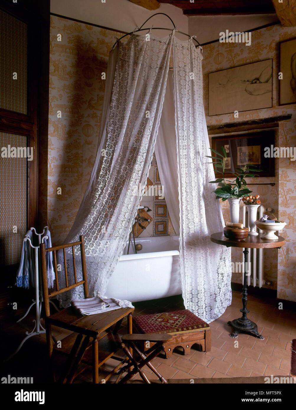 A Traditional Country Style Bathroom With Freestanding Roll Top Bath Shower Curtain Tiled Floor