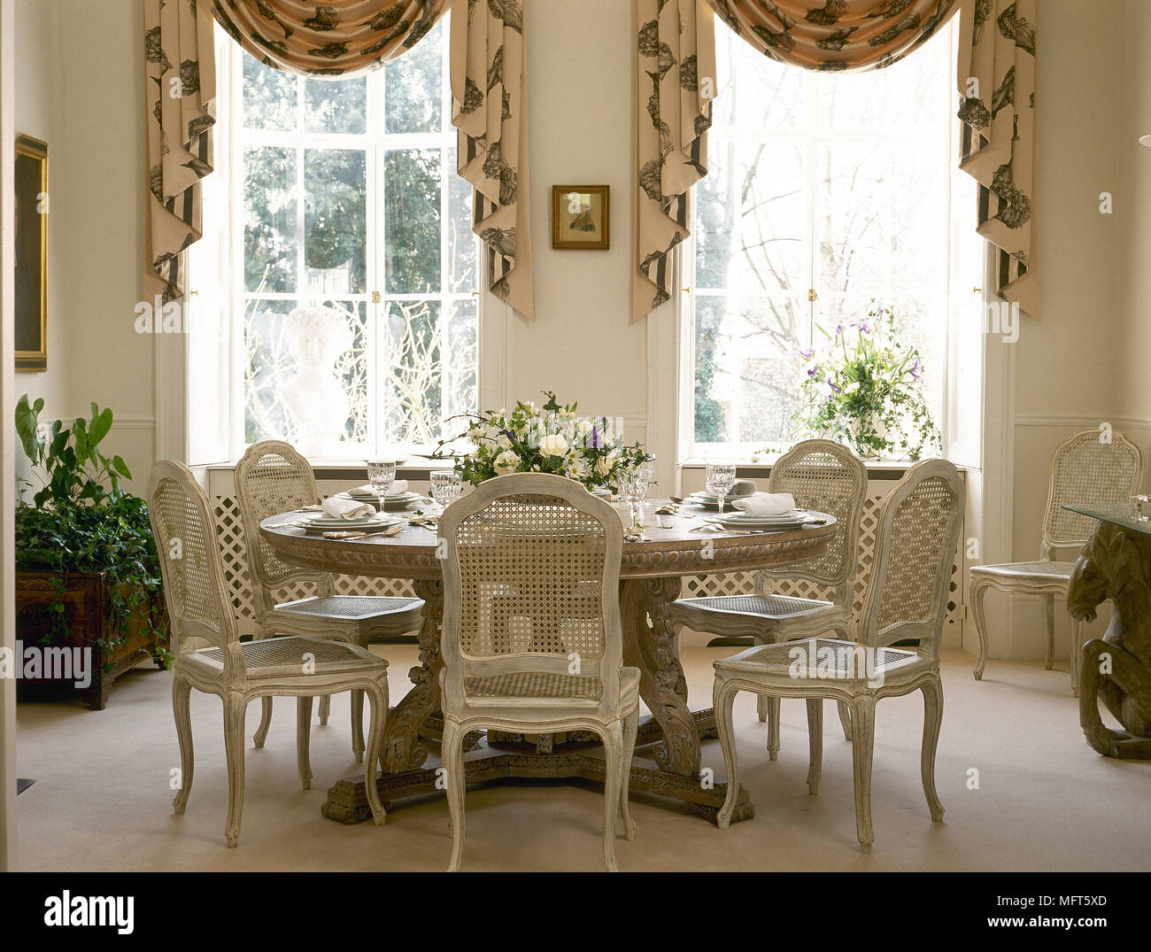 Incroyable A Traditional, Neutral Dining Room With Round Table, Painted Period Chairs, Swag  Curtains,