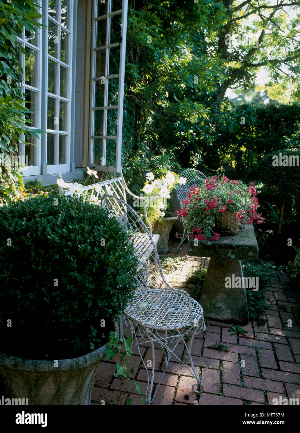 Sensational A Detail Of A Country Garden With A Paved Patio Area Customarchery Wood Chair Design Ideas Customarcherynet