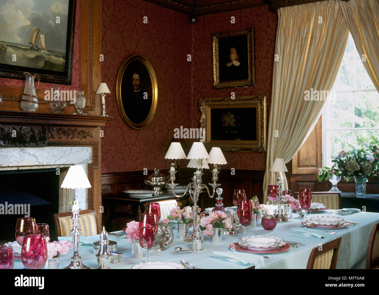 A Traditional Red Dining Room With Marble Fireplace Table Laid Formal Setting