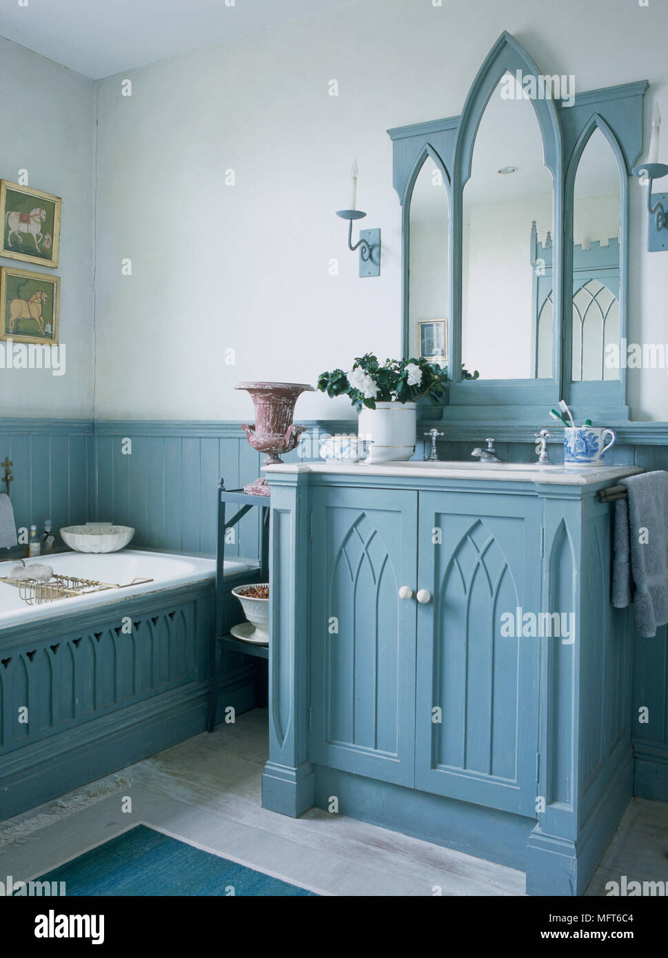 A detail of a traditional country, blue bathroom, was basin in a ...