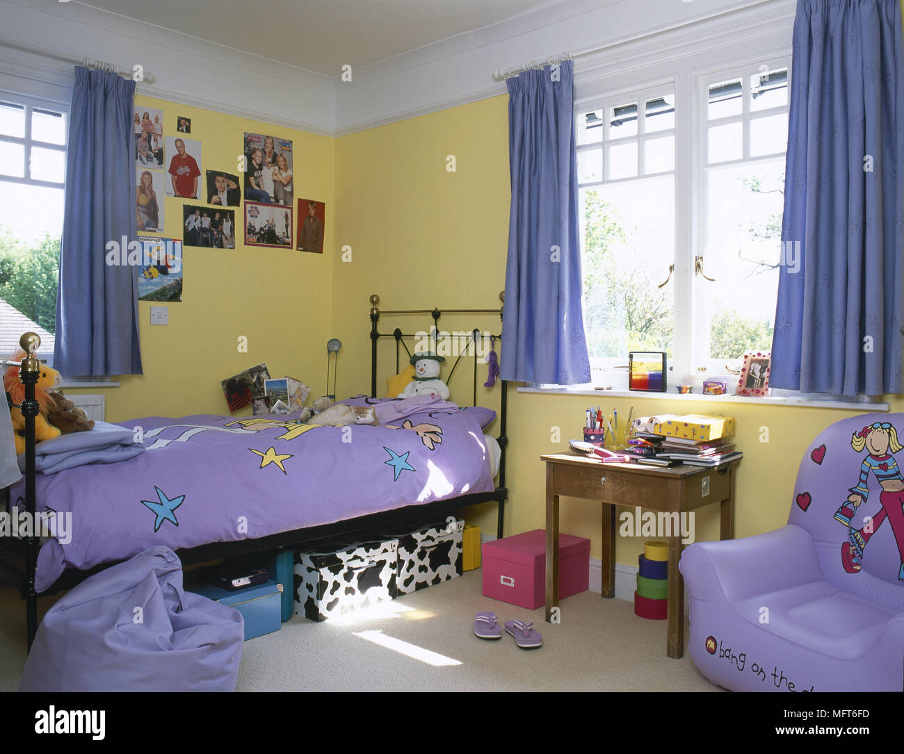 Child\'s, yellow bedroom with brass bed, blue curtains ...