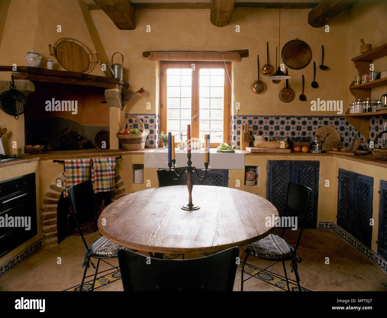 - Rustic, Eat-in Kitchen With Round Table And Chairs, Beamed Ceiling